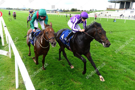 Stock Image of CURRAGH. INNISFREE and Donnacha O'Brien (right) win The Beresford Stakes for trainer Aidan O'Brien from SHEKHEM (left,green).