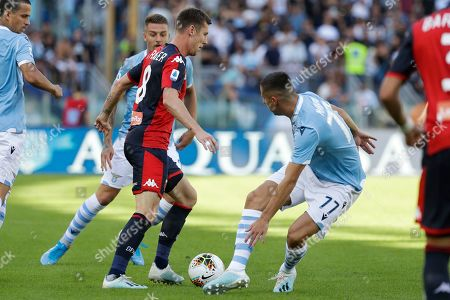 Genoa's Lukas Lerager takes on Lazio's Adam Marusic, right, during a Serie A soccer match between Lazio and Genoa, at the Rome Olympic Stadium
