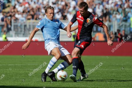 Lazio's Lucas Leiva, left, and Genoa's Lukas Lerager vie for the ball during a Serie A soccer match between Lazio and Genoa, at the Rome Olympic Stadium