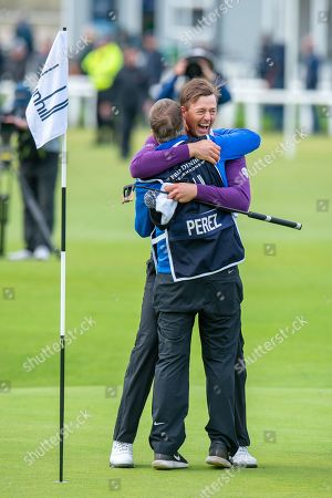 Winner Victor Perez is hugged by his caddie JP Fitzgerald after sinking the winning put during the final round of the Alfred Dunhill Links Championship European Tour at St Andrews, West Sands