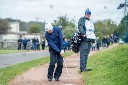 Gerry McIlroy, father of Rory McIlroy, plays his shot from the path next to the green on the 16th green during the final round of the Alfred Dunhill Links Championship European Tour at St Andrews, West Sands