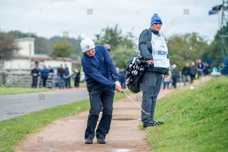 Stock Photo of Gerry McIlroy, father of Rory McIlroy, plays his shot from the path next to the green on the 16th green during the final round of the Alfred Dunhill Links Championship European Tour at St Andrews, West Sands