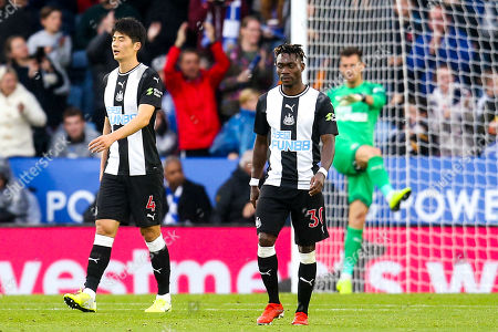 Stock Photo of Christian Atsu of Newcastle United and Ki Sung-Yueng of Newcastle United cut dejected figures