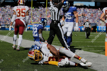 Washington Redskins cornerback Josh Norman reacts after being hurt on play during the first half of an NFL football game against the New York Giants, in East Rutherford, N.J