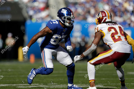 New York Giants' Sterling Shepard, left, goes up against Washington Redskins' Josh Norman during the second half of an NFL football game, in East Rutherford, N.J