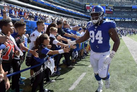 Stock Photo of New York Giants defensive end Dalvin Tomlinson (94) greets fans before an NFL football game against the Washington Redskins, in East Rutherford, N.J