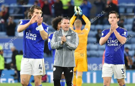 Leicester's manager Brendan Rodgers, center and his players Caglar Soyuncu, left, Ben Chilwell, right, react after the English Premier League soccer match between Leicester City and Newcastle United at the King Power Stadium in Leicester, England