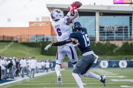 Louisiana Tech Bulldogs wide receiver Adrian Hardy (6) makes a touchdown catch while being defended by Rice Owls cornerback Andrew Bird (15) during the 1st quarter of an NCAA football game between the Louisiana Tech Bulldogs and the Rice Owls at Rice Stadium in Houston, TX. Louisiana Tech won the game 23 to 20 in overtime