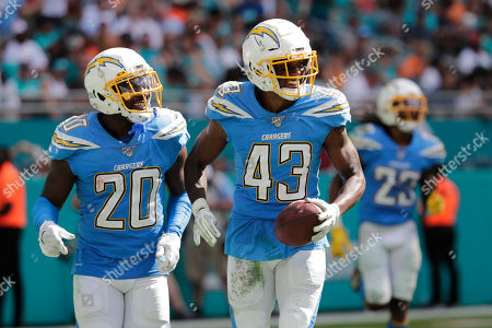 Desmond King, Michael Davis. Los Angeles Chargers defensive back Desmond King (20) congratulate cornerback Michael Davis (43) after Davis intercepted a pass, during the second half at an NFL football game against the Miami Dolphins, in Miami Gardens, Fla. The Chargers defeated the Dolphins 30-10