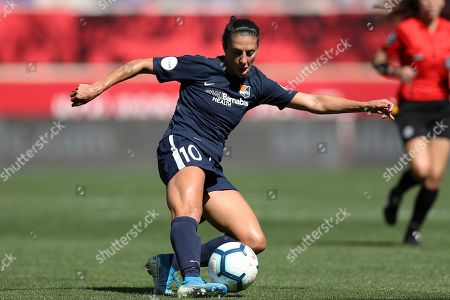 Sky Blue FC midfielder Carli Lloyd (10) passes the ball during the second half of an NWSL soccer match against the Orlando Pride, in Harrison, N.J. The match ended in a 1-1 draw