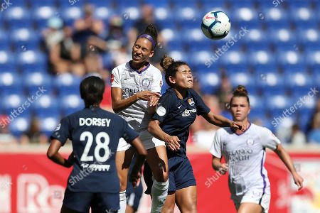Orlando Pride midfielder Kristen Edmonds (12) and Sky Blue FC midfielder Raquel Rodriguez (11) jump up to head the ball during the first half of an NWSL soccer match, in Harrison, N.J. The match ended in a 1-1 draw
