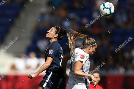 Sky Blue FC midfielder Carli Lloyd (10) and Orlando Pride defender Shelina Zadorsky (4) jump up to head the ball during the second half of an NWSL soccer match, in Harrison, N.J. The match ended in a 1-1 draw