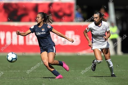 Sky Blue FC defender Caprice Dydasco (3) moves the ball away from Orlando Pride forward Marta (10) during the second half of an NWSL soccer match, in Harrison, N.J. The match ended in a 1-1 draw