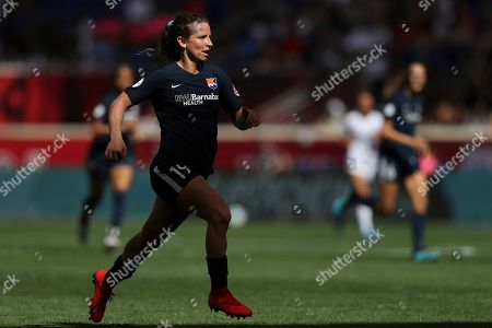 Stock Image of Sky Blue FC midfielder Elizabeth Eddy (19) runs up the field during the second half of an NWSL soccer match against the Orlando Pride, in Harrison, N.J. The match ended in a 1-1 draw