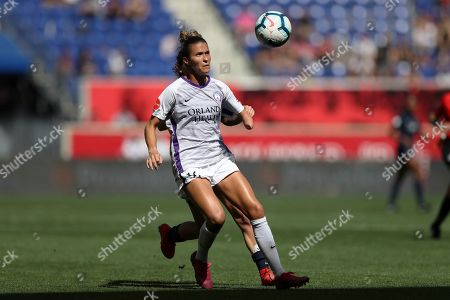 Orlando Pride defender Carson Pickett (16) eyes the ball while Sky Blue FC midfielder Elizabeth Eddy (19) defends behind her during the second half of an NWSL soccer match, in Harrison, N.J. The match ended in a 1-1 draw