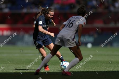 Sky Blue FC midfielder Elizabeth Eddy (19) passes the ball while Orlando Pride defender Carson Pickett (16) defends during the second half of an NWSL soccer match, in Harrison, N.J. The match ended in a 1-1 draw