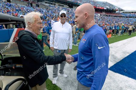 Stock Picture of Former Buffalo Bills head coach Marv Levy, left, speaks to current head coach Sean McDermott, right, before an NFL football game between the Bills and the New England Patriots, in Orchard Park, N.Y