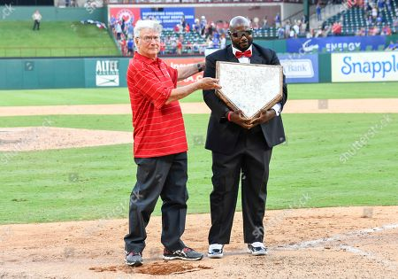 Former Arlington Mayor Richard Greene pulls up the home plate and hands the plate to grounds keeper Devo Spencer on the right to take to the new field after the final Major League Baseball game held at Globe Life Park between the New York Yankees and the Texas Rangers in Arlington, TX Texas defeated New York 6-1 Albert Pena/CSM