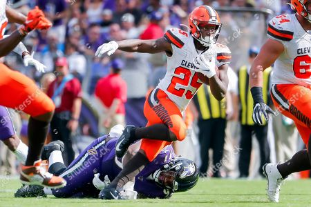 Cleveland Browns running back Dontrell Hilliard (R) in action against Baltimore Ravens defensive tackle Michael Pierce (L) during the second half of the NFL American football game between the Cleveland Browns and the Baltimore Ravens at M & T Bank Stadium in Baltimore, Maryland, USA, 29 September 2019.