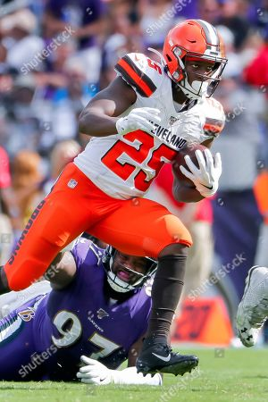 Stock Picture of Cleveland Browns running back Dontrell Hilliard (R) in action against Baltimore Ravens defensive tackle Michael Pierce (L) during the second half of the NFL American football game between the Cleveland Browns and the Baltimore Ravens at M & T Bank Stadium in Baltimore, Maryland, USA, 29 September 2019.