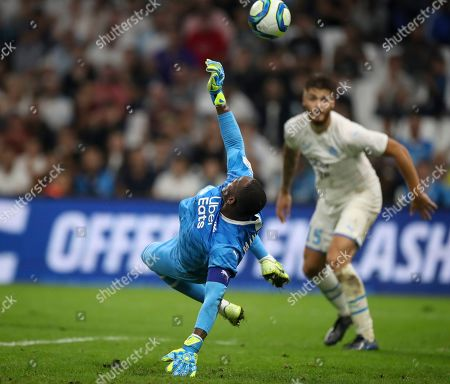 ONE. Marseille's goalkeeper Steve Mandanda saves a goal during the second half of the French League One soccer match between Marseille and Rennes at the Velodrome stadium in Marseille, southern France