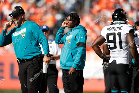 Jacksonville Jaguars cornerback Jalen Ramsey, center, stands on the sidelines alongside defensive coordinator Todd Wash, left, during the first half of an NFL football game against the Denver Broncos, in Denver