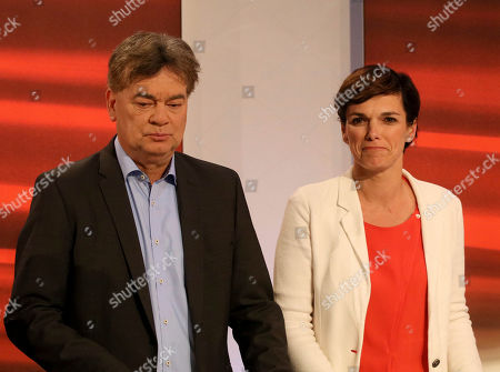 Werner Kogler of the Austrian Greens, left, and Pamela Rendi-Wagner head of the Austrian Social Democrats, SPOe, look prior to a TV interview after the closing of the polling stations for the Austrian national elections in Vienna, Austria