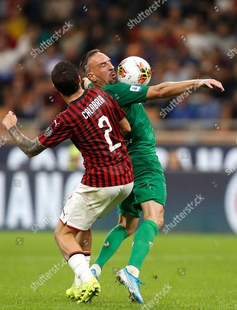 AC Milan's Davide Calabria, left, and Fiorentina's Franck Ribery fight for the ball during a Serie A soccer match between AC Milan and Fiorentina, at the San Siro stadium in Milan, Italy