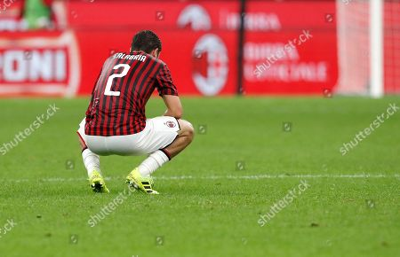 AC Milan's Davide Calabria sits on the pitch at the end of the Serie A soccer match between AC Milan and Fiorentina, at the San Siro stadium in Milan, Italy