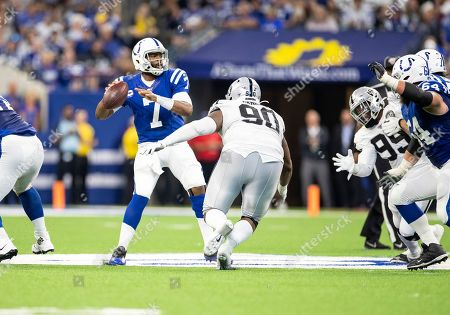Stock Photo of Indianapolis Colts quarterback Jacoby Brissett (7) passes the ball as Oakland Raiders defensive tackle Johnathan Hankins (90) pursues during NFL football game action between the Oakland Raiders and the Indianapolis Colts at Lucas Oil Stadium in Indianapolis, Indiana. Oakland defeated Indianapolis 31-24