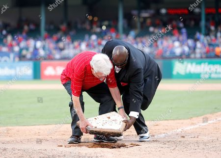 Richard Greene, Devo Spencer. Former Arlington, Texas, Mayor Richard Greene and Texas Rangers grounds crew employee Devo Spencer, right, remove home plate from Globe Life Park before parading it over to Globe Life Field following a baseball game between the New York Yankees and Texas Rangers in Arlington, Texas, . The contest was the final game at the park
