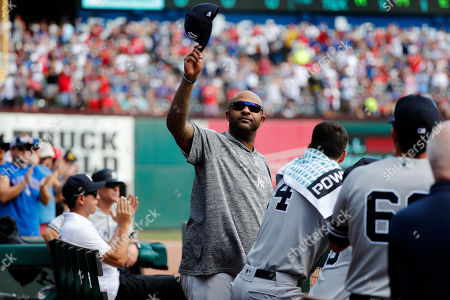 New York Yankees' CC Sabathia acknowledges cheers from fans after he was celebrated by the Texas Rangers in the second inning of a baseball game in Arlington, Texas