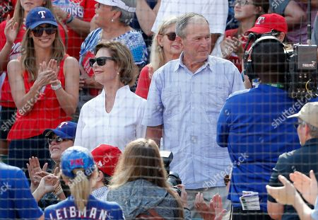George W. Bush, Larua Bush. Former first lady Laura Bush, center left, and former President George W. Bush, center right, stand after being introduced in the fifth inning of a baseball game between the New York Yankees and Texas Rangers in Arlington, Texas