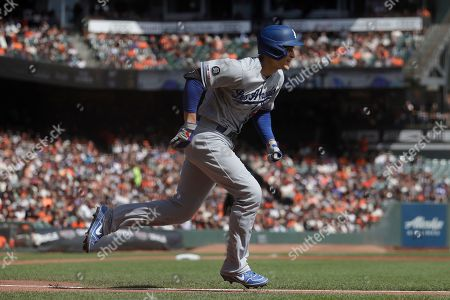 Los Angeles Dodgers' Corey Seager runs after hitting a three-run double against the San Francisco Giants during the first inning of a baseball game in San Francisco
