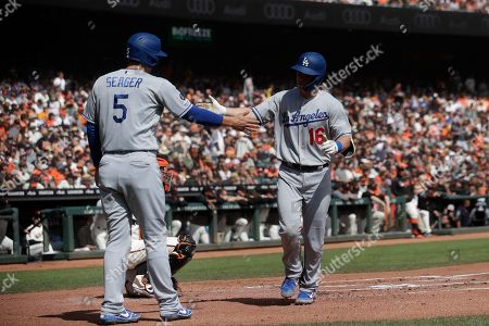Los Angeles Dodgers' Will Smith, right, celebrates after hitting a two-run home run that scored Corey Seager, left, against the San Francisco Giants during the first inning of a baseball game in San Francisco