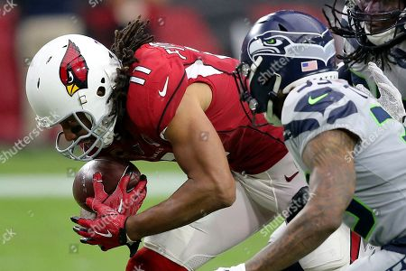 Arizona Cardinals wide receiver Larry Fitzgerald (11) catches his career 1,325 catch to tie Tony Gonzalez for second place on the all-time receptions list during the second half of an NFL football game against the Seattle Seahawks, in Glendale, Ariz