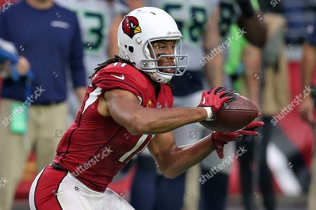 Arizona Cardinals wide receiver Larry Fitzgerald (11) catches his career 1,326 catch to pass Tony Gonzalez for second place on the all-time receptions list during the second half of an NFL football game against the Seattle Seahawks, in Glendale, Ariz