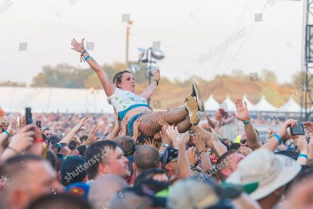 Benjamin Burnley. Festival goers crowd surf as Breaking Benjamin performs during Louder Than Life at Highland Festival Grounds at KY Expo Center, in Louisville, Ky