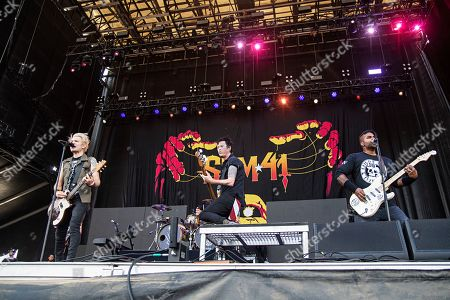 Deryck Whibley Dave Baksh Jason McCaslin. Deryck Whibley, from left, Jason McCaslin, and Dave Baksh of Sum 41 perform during Louder Than Life at Highland Festival Grounds at KY Expo Center, in Louisville, Ky