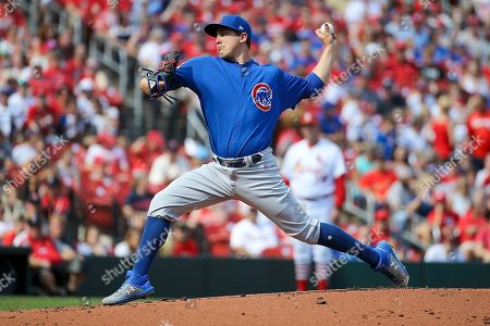 Chicago Cubs starting pitcher Derek Holland delivers during the first inning of a baseball game against the St. Louis Cardinals, in St. Louis