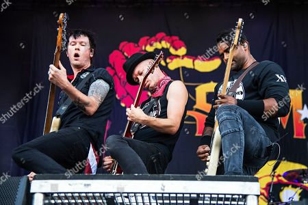 Stock Picture of Dave Baksh Tom Thacker Jason McCaslin. Jason McCaslin, from left, Tom Thacker and Dave Baksh of Sum 41 perform during Louder Than Life at Highland Festival Grounds at Kentucky Expo Center, in Louisville, Ky