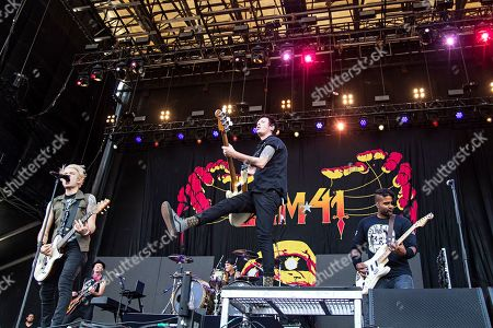 Deryck Whibley Dave Baksh Jason McCaslin. Deryck Whibley, from left, Jason McCaslin and Dave Baksh of Sum 41 perform during Louder Than Life at Highland Festival Grounds at Kentucky Expo Center, in Louisville, Ky