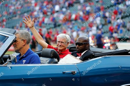 Stock Photo of Richard Greene, Devo Spencer. Former Arlington, Texas, Mayor Richard Greene waves as Texas Rangers grounds crew employee Devo Spencer, right, helps him parade home plate from Globe Life Park over to Globe Life Field following a baseball game against the New York Yankees in Arlington, Texas, . The game was the final game at the park for the Rangers. They will open up their new stadium in the 2020 season