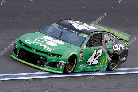 Kyle Larson drives through Turn 4 during the NASCAR Cup Series auto race at Charlotte Motor Speedway in Concord, N.C