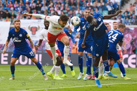 (190929) -- LEIPZIG, Sept. 29, 2019 (Xinhua) -- Matheus Cunha (L, front) of RB Leipzig vies with Salif Sane (R, front) of FC Schalke 04 during the Bundesliga soccer match between RB Leipzig and FC Schalke 04 in Leipzig , Germany, on Sept. 28, 2019. (