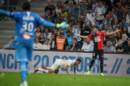 ONE. Rennes' Adrien Hunou and Marseille's goalkeeper Steve Mandanda react during the French League One soccer match between Marseille and Rennes at the Velodrome stadium in Marseille, southern France