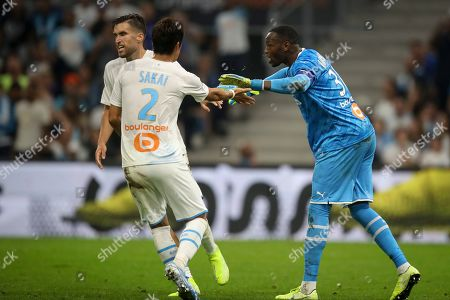ONE. Marseille's goalkeeper Steve Mandanda high five's his teammates after saving a goal during the second half of the French League One soccer match between Marseille and Rennes at the Velodrome stadium in Marseille, southern France