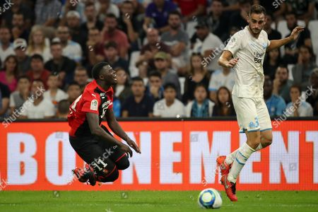 ONE. Rennes' M'Baye Niang crashes to the ground after a tackle by Marseille's Lucas Perrin during the French League One soccer match between Marseille and Rennes at the Velodrome stadium in Marseille, southern France