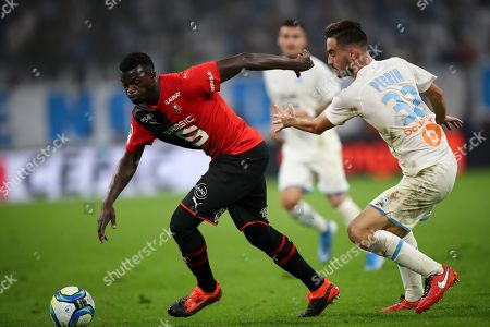 ONE. Rennes' M'Baye Niang gets past Marseille's Lucas Perrin during the French League One soccer match between Marseille and Rennes at the Velodrome stadium in Marseille, southern France