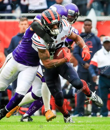 Chicago Bears wide receiver Allen Robinson (front) is tackled by Minnesota Vikings outside linebacker Anthony Barr (back) during the American football game between the Minnesota Vikings and the Chicago Bears at Soldier Field in Chicago, Illinois, USA, 29 September 2019.